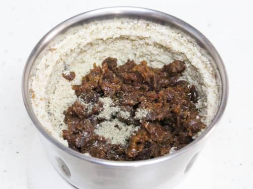 adding jaggery and cardamom powder for walnut ladoo