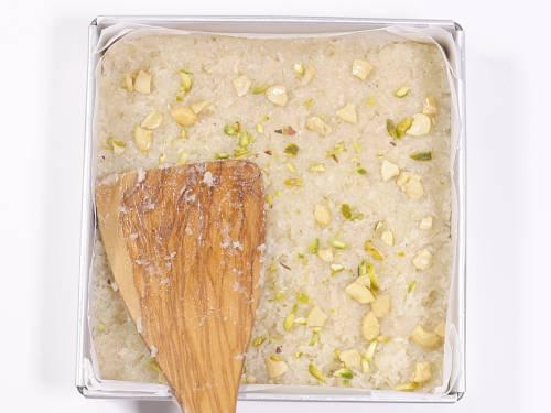 setting coconut burfi in pan