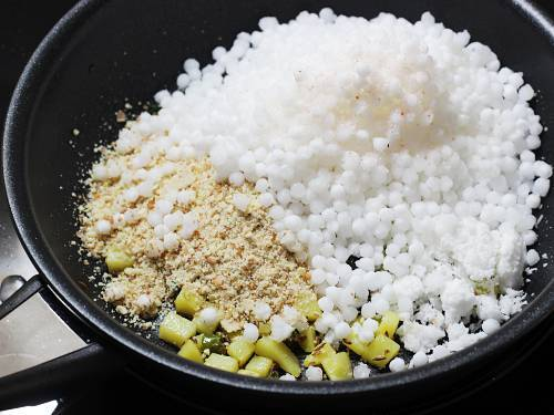 adding sabudana crushed peanuts and salt