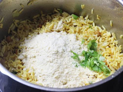 adding fried gram powder and coriander leaves