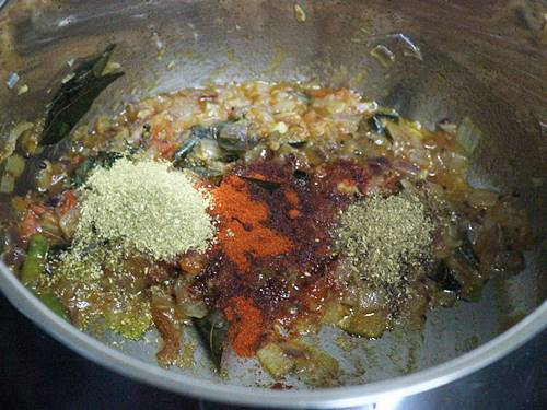 sauteing masala to make green gram curry