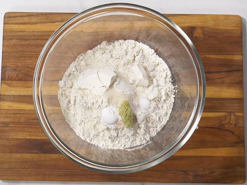 adding dry ingredients to make naan