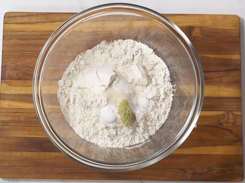 adding dry ingredients to make naan