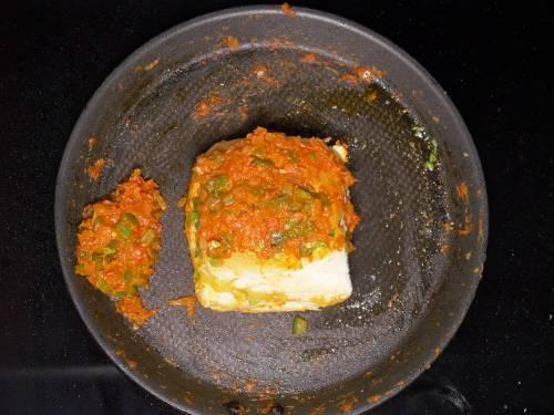 masala topped on toasted pav