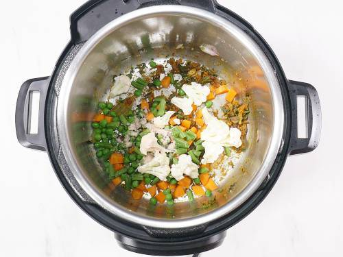 adding mint, spices and veggies to the pot