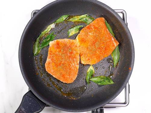 frying salmon in a pan