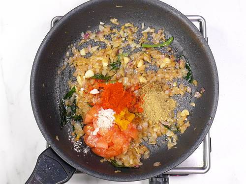 adding spice powders to the pan
