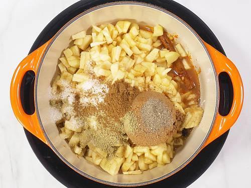 adding sugar cumin and fennel to make apple chutney