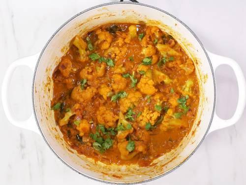 garnish cauliflower curry with coriander leaves
