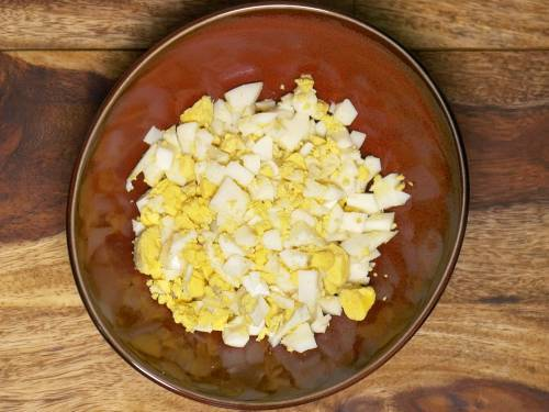 chopped eggs for salad in a mixing bowl