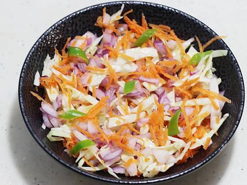 mixed veggies in a black bowl
