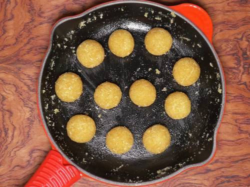 coconut ladoos with jaggery in a pan