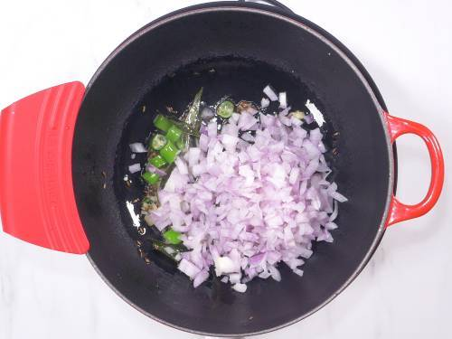 sauteing onions to make zucchini curry