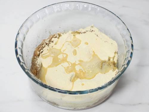 adding hot oil over gram flour