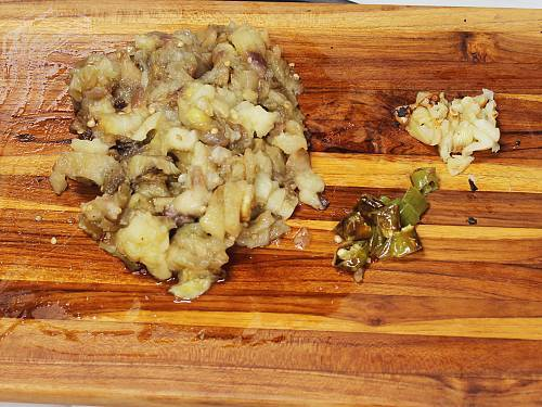chopped baingan garlic and chilies for making bharta