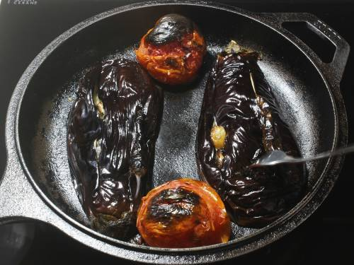 broiled eggplants tomatoes in a pan