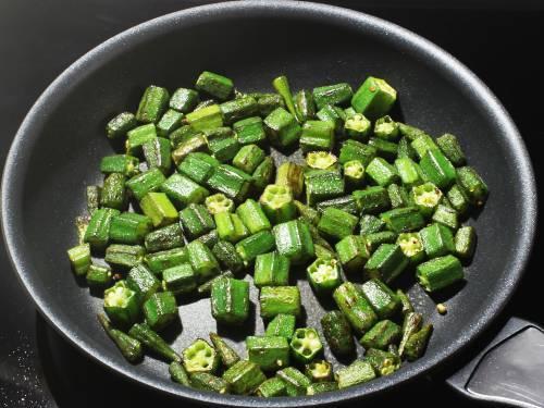 semi fried okra in a pan