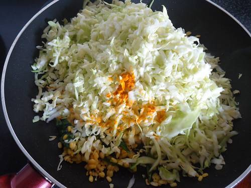 adding cabbage for frying