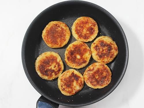 crisp fried potato patties in pan