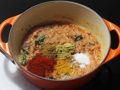 adding spice powders to make carrot curry