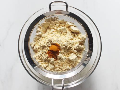 sieve besan and turmeric to make dhokla