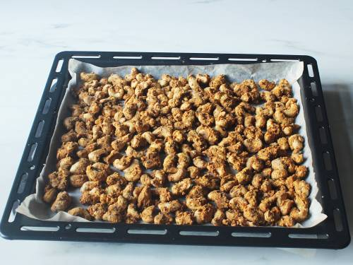 roasted cashews cooling on the rack