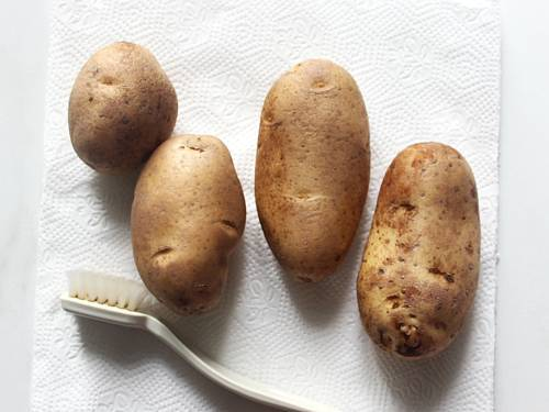brushing potatoes to make wedges