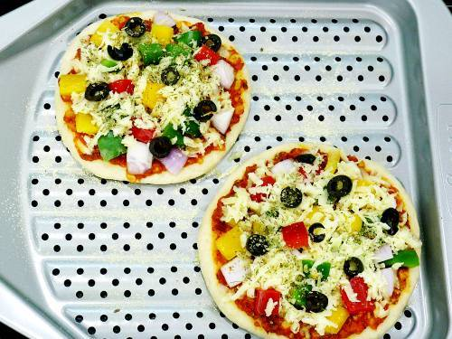 thick crust pizza on a perforated baking pan