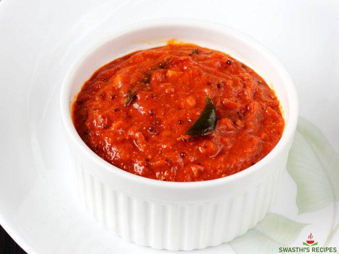 spicy tomato chutney in a white bowl
