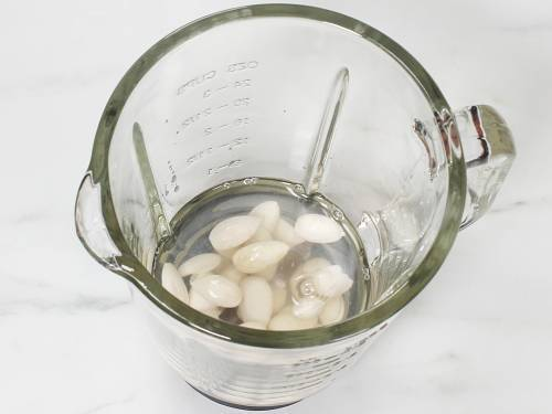 peeled almonds in a blender