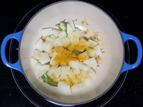 turmeric sprinkled over potatoes