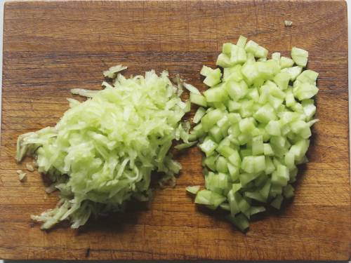 chopped and grated cucumbers on chopping board for raita