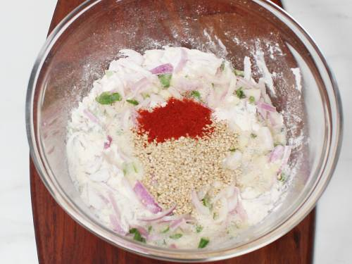 red chilli powder sesame seeds in a mixing bowl