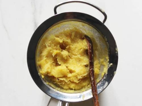 pineapple pulp in a strainer