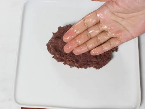 greased fingers to knead ragi mudde
