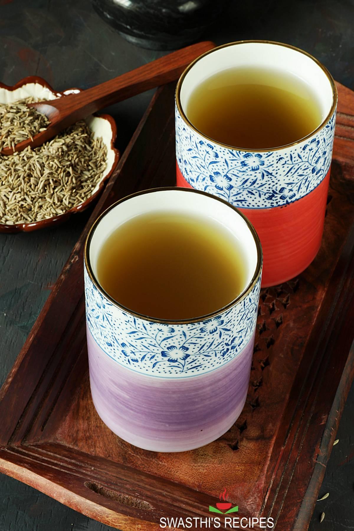 Jeera water in 2 serving cups