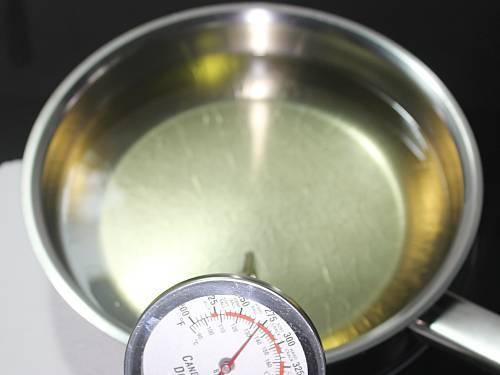 heat oil in a heavy bottom pan