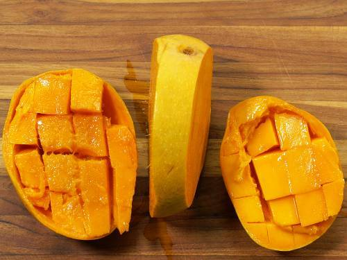 cubed mangoes on a board