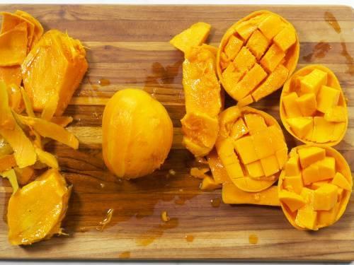 chopped alphonso mangoes on a board