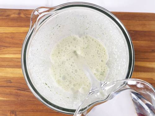 pour water to spiced yogurt to make pudina chaas