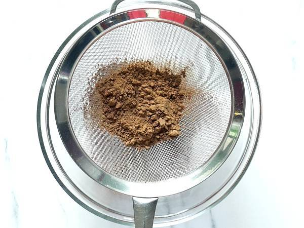 add cocoa powder to a sieve