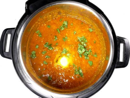 butter and coriander leaves garnished over bhaji