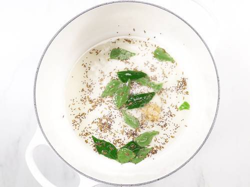 tempering spices in oil for misal pav