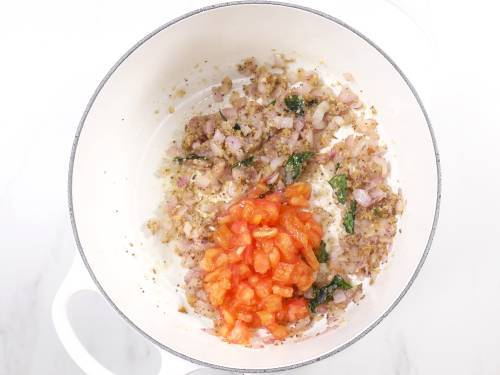 add tomatoes and salt to make misal pav