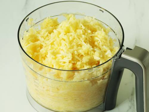 grated apples in a food processor