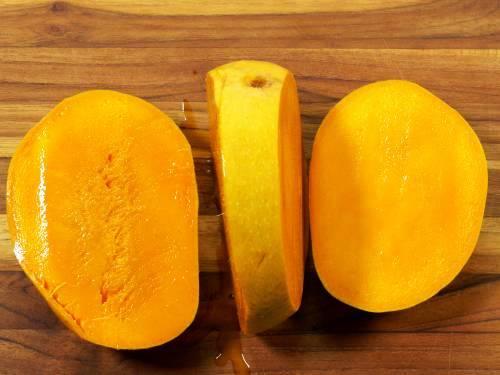 2 halves of a cut mango