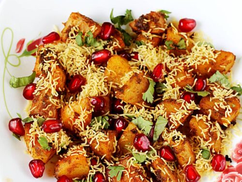 aloo chaat garnished with crunchy sev and pomegranate arils