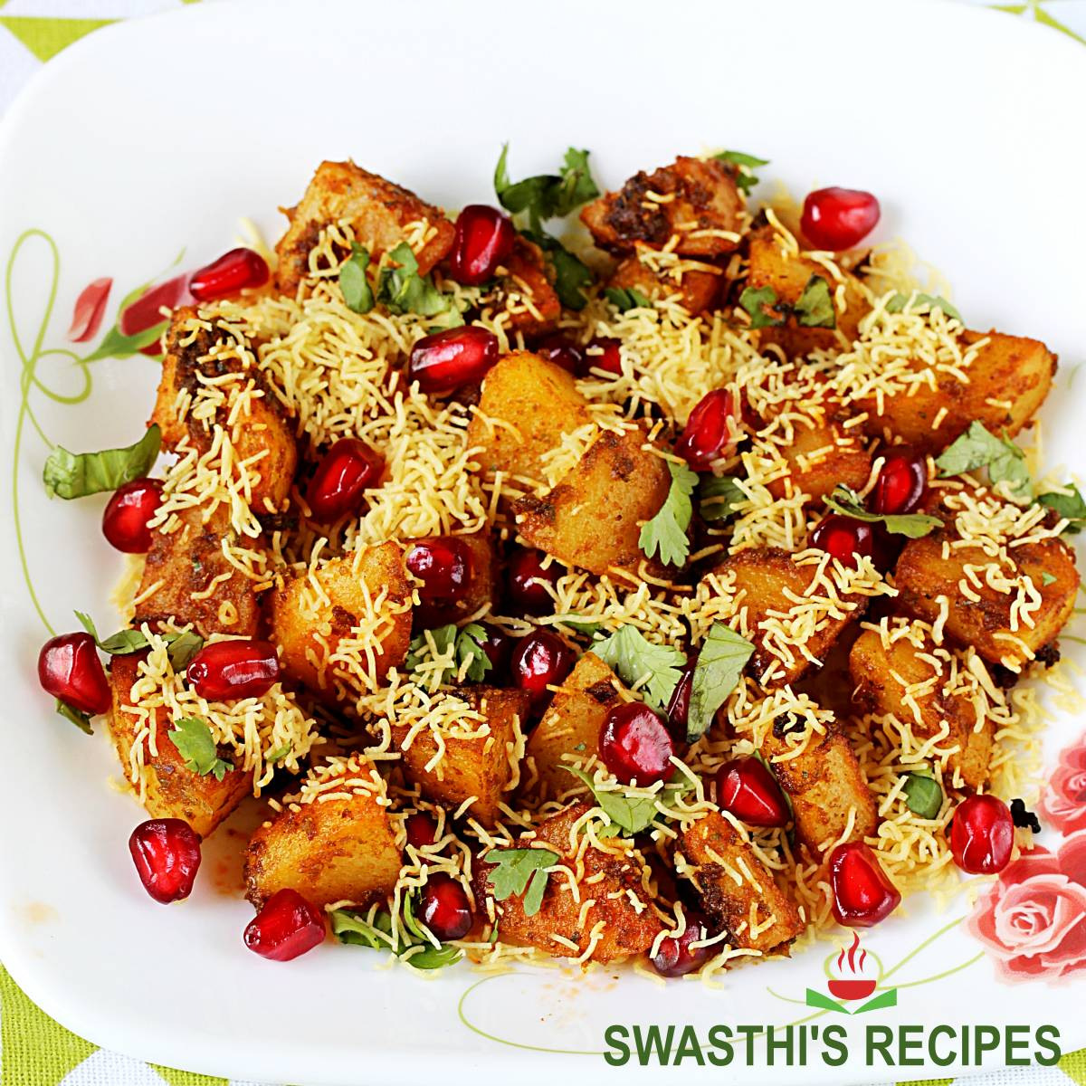 aloo chaat made with pan fried potatoes, ground spices and sev