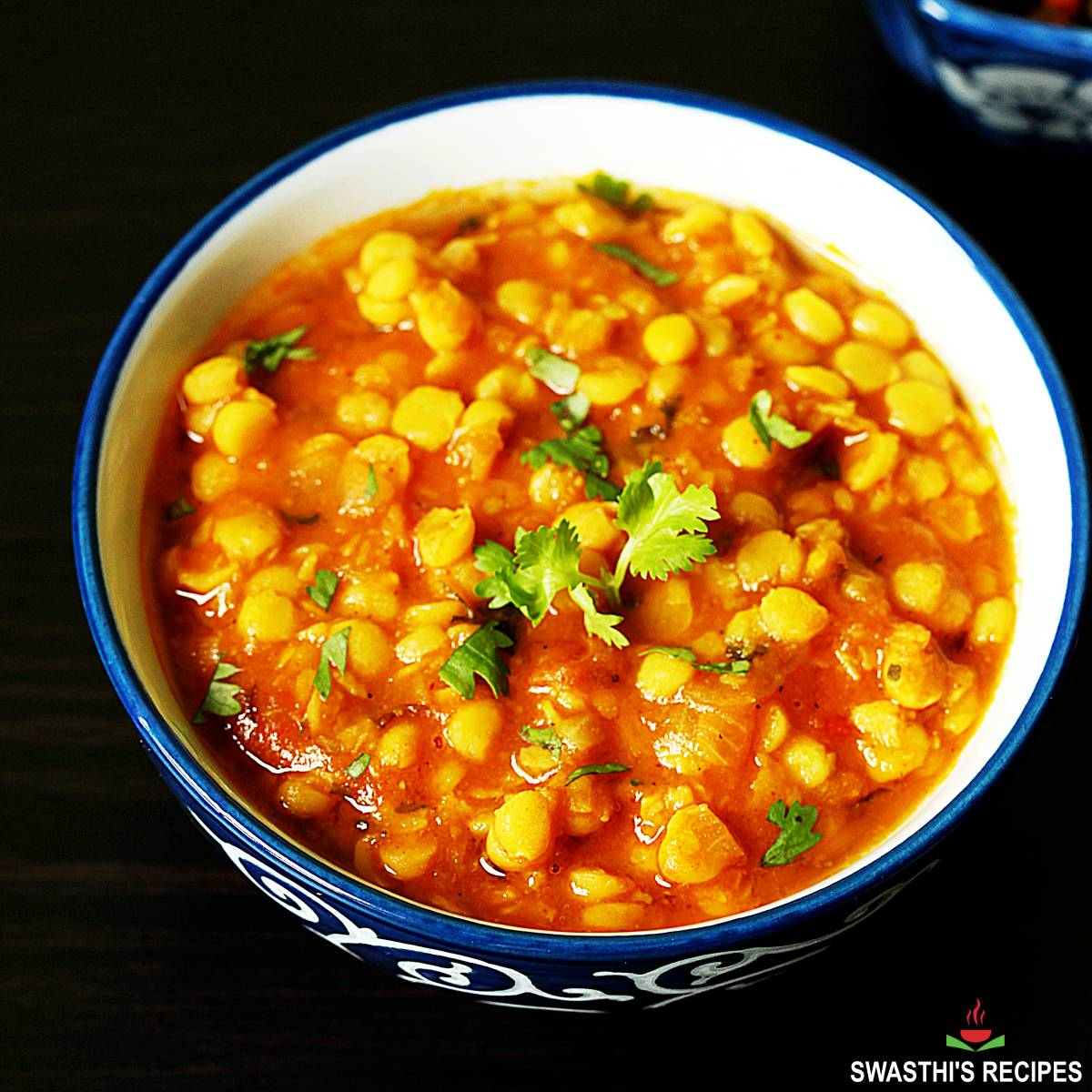 chana dal served in a blue and white bowl