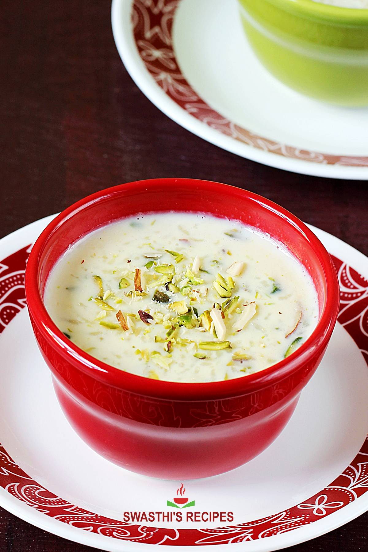 kheer recipe - rice kheer served in a bowl garnished with nuts